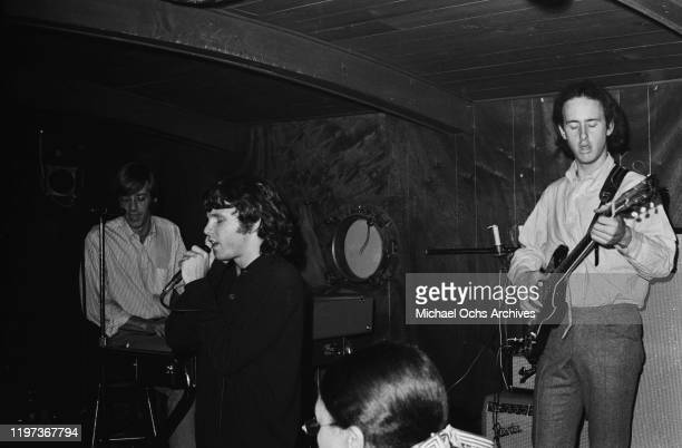 American rock band The Doors perform at the Ondine Club in New York City November 1966 From left to right keyboard player Ray Manzarek singer Jim...