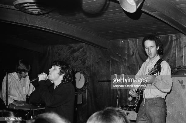 American rock band The Doors perform at the Ondine Club in New York City, November 1966. From left to right, keyboard player Ray Manzarek, singer Jim...