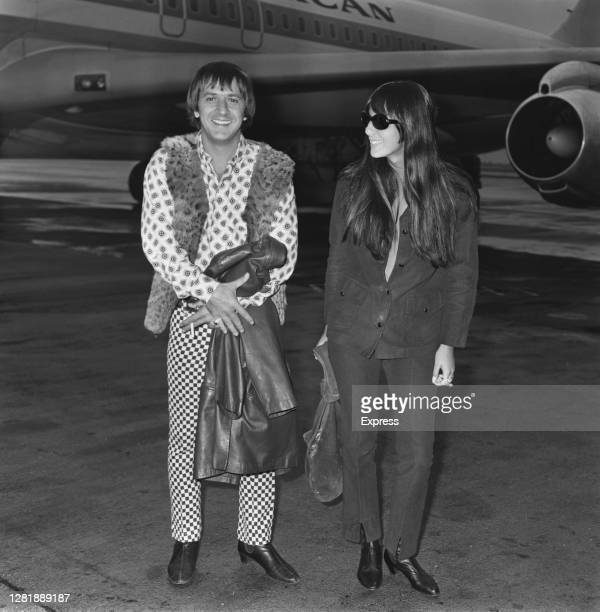 American rock duo Sonny and Cher arrive at London Airport, UK, 22nd July 1966. They are husband and wife Sonny Bono and Cher.