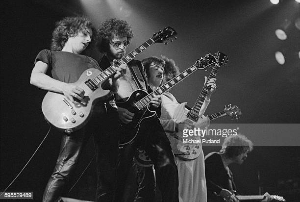 American rock group Blue Oyster Cult all playing guitars on stage USA 30th July 1976 Left to right Allen Lanier Eric Bloom Donald 'Buck Dharma'...