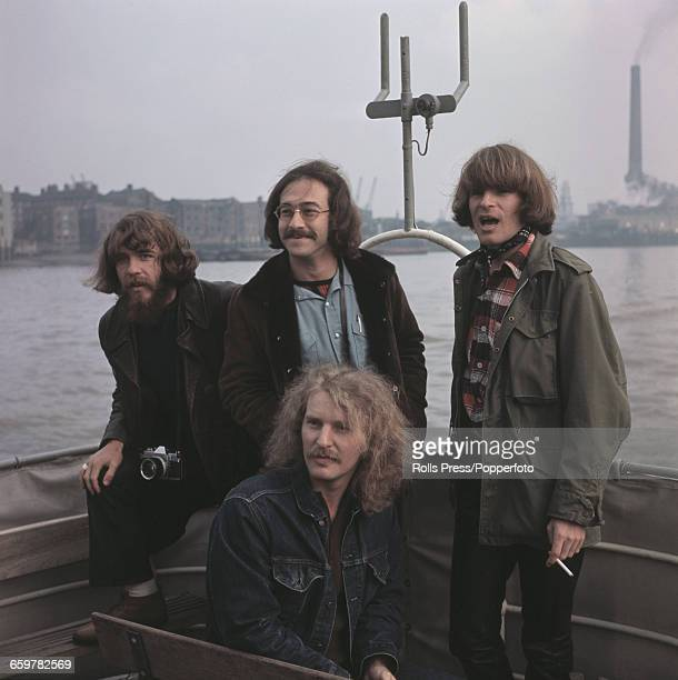 American rock group Creedence Clearwater Revival pictured together on a boat on the River Thames in London during the band's first tour of Europe in...