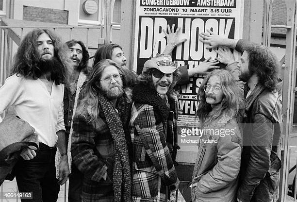 American rock group Dr Hook the Medicine Show with a poster advertising one of their Amsterdam concerts Netherlands March 1974 Left to right George...
