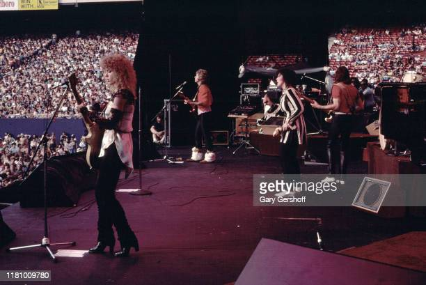 American Rock group Heart performs onstage at Giants Stadium, East Rutherford, New Jersey, June 15, 1980. Pictured are, from left, Nancy Wilson and...