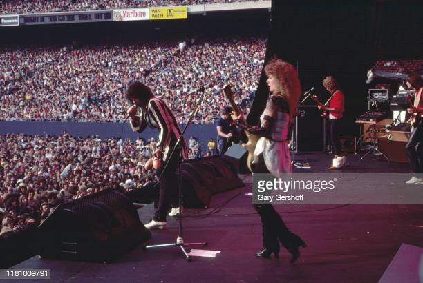 American Rock group Heart performs onstage at Giants Stadium, East Rutherford, New Jersey, June 15, 1980. Pictured are, from left, sisters Ann Wilson...