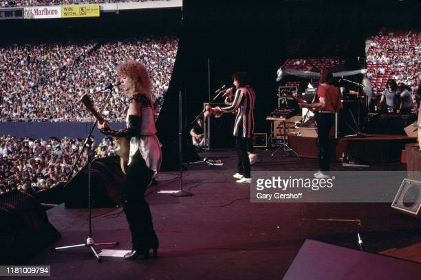 American Rock group Heart performs onstage at Giants Stadium, East Rutherford, New Jersey, June 15, 1980. Pictured are, from left, sisters Nancy...