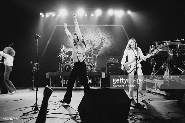 American rock group Journey performing on their 'Departure' tour, 1980. Left to right: Neal Schon, Steve Perry and Ross Valory.