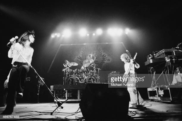 American rock group Journey performing on their 'Departure' tour, 1980. Left to right: Steve Perry, Aynsley Dunbar and Ross Valory.