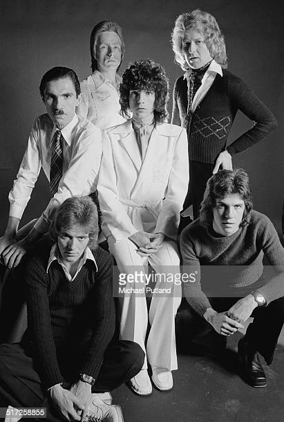 American rock group Sparks, 1974. Clockwise, from bottom left: bassist Ian Hampton, keyboard player Ron Mael, guitarist Trevor White, singer Russell...