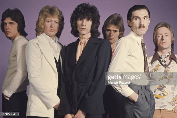 American rock group Sparks posed together in London in May 1974. Left to right: guitarist Adrian Fisher, drummer Norman 'Dinky' Diamond, singer...
