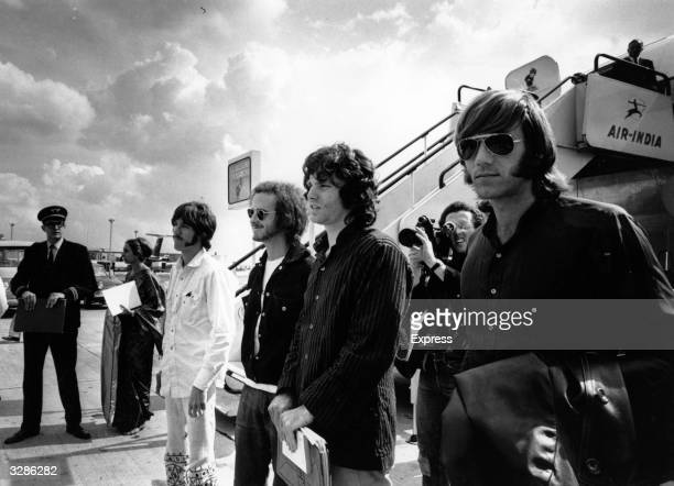 American rock group The Doors arrive at London Airport in 1968 they are from left to right John Densmore Bobby Krieger Jim Morrison and Ray Manzarek