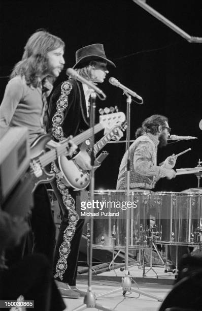 American rock group the James Gang performing on the BBC television show 'Top of the Pops' London 4th August 1971 Left to right Dale Peters Joe Walsh...