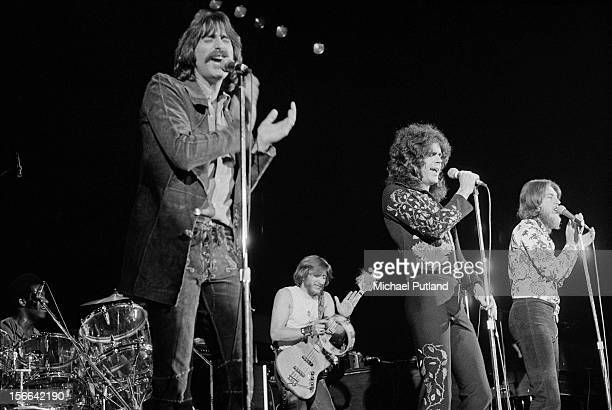 American rock group Three Dog Night performing, at the Sundown, Edmonton, London, 6th October 1972. At the microphones are Chuck Negron, Danny Hutton...