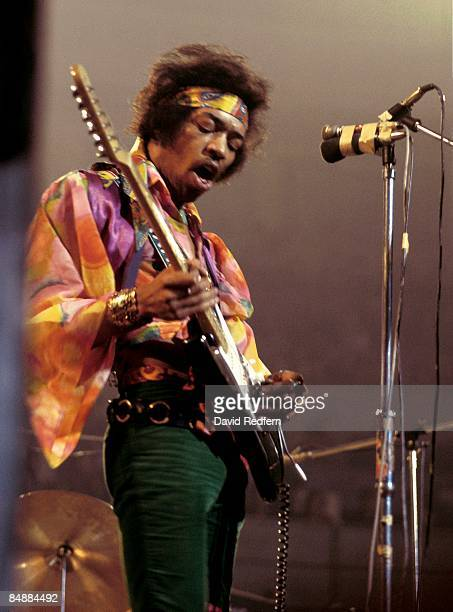 American rock guitarist and singer Jimi Hendrix performs live on stage playing a black Fender Stratocaster guitar with The Jimi Hendrix Experience at...