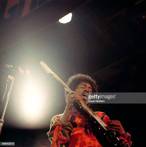 American rock guitarist and singer Jimi Hendrix performs live on stage at the 1970 Isle of Wight Festival at Afton Down on the Isle of Wight on the...