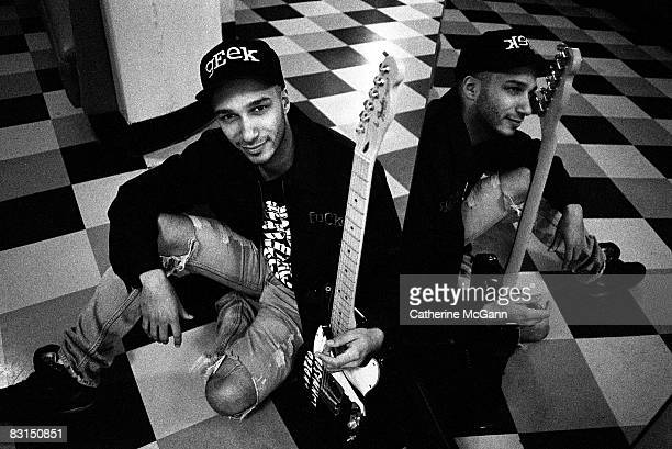 American rock guitarist Tom Morello of bands Rage Against the Machine and Audioslave poses for a portrait holding his guitar in March 1993 in New...