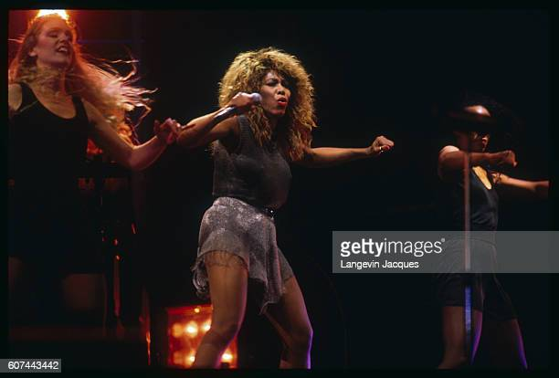American rock music legend Tina Turner and her backup singers and dancers perform during a concert at the Versailles Palace