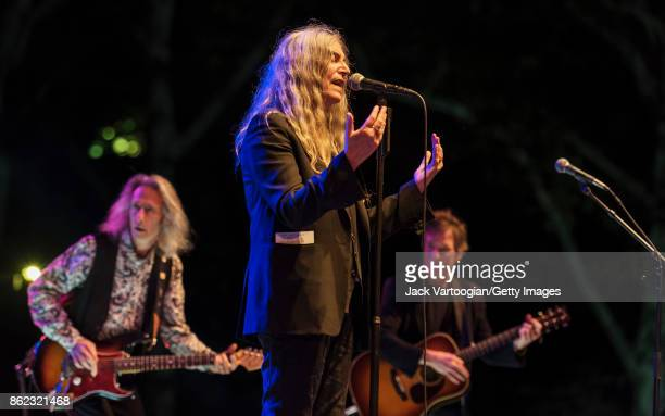 American Rock musician and poet Patti Smith leads her band during a tribute to her late husband guitarist Fred 'Sonic' Smith at Central Park...
