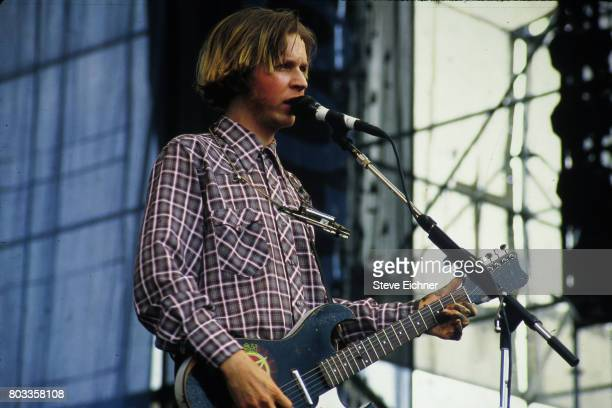 American Rock musician Beck plays guitar as he performs onstage during the Lollapalooza festival at Randall's Island's Downing Stadium New York New...