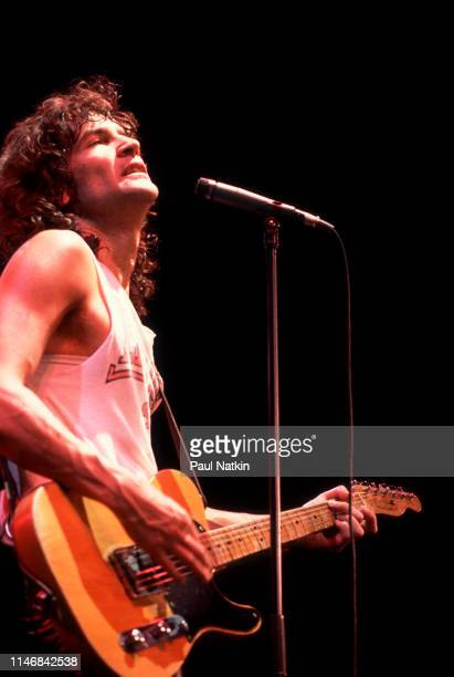 American Rock musician Billy Squier plays guitar as he performs onstage at the UIC Pavilion, Chicago, Illinois, April 1, 1983.
