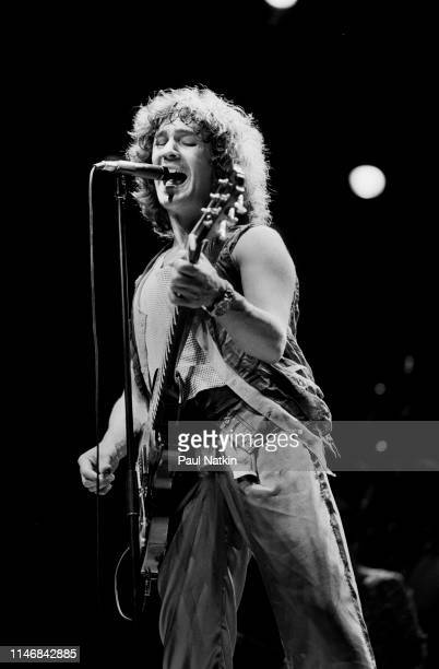 American Rock musician Billy Squier plays guitar as he performs onstage at the Poplar Creek Music Theater, Hoffman Estates, Illinois, September 2,...