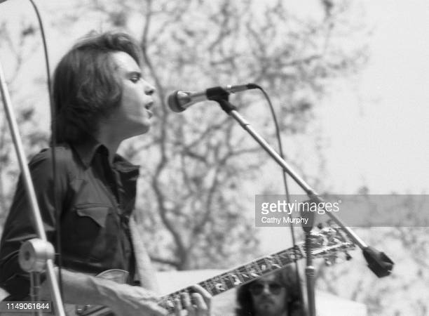 American Rock musician Bob Weir of the group Grateful Dead plays guitar as he performs on stage at the Santa Barbara County Bowl Santa Barbara...