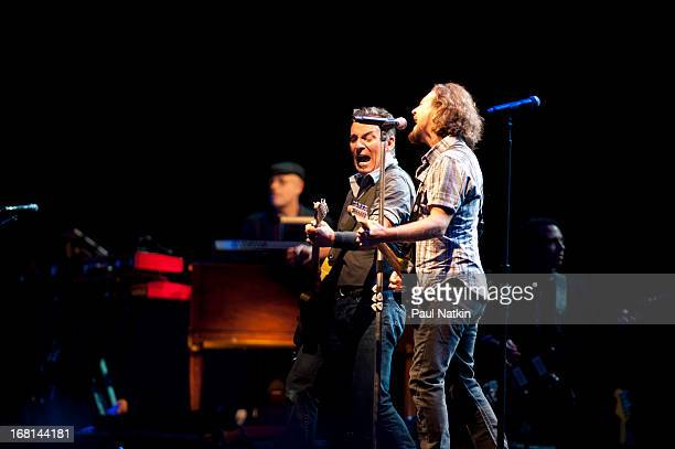 American rock musician Bruce Springsteen performs on stage with the E Street Band and special guest Eddie Vedder during the 'Wrecking Ball' tour at...