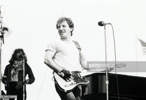 American Rock musician Bruce Springsteen performs onstage, St James' Park, Newcastle, 6/4/1985.