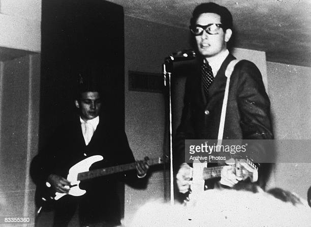 American rock musician Buddy Holly performing on stage with his band The Crickets 1950s
