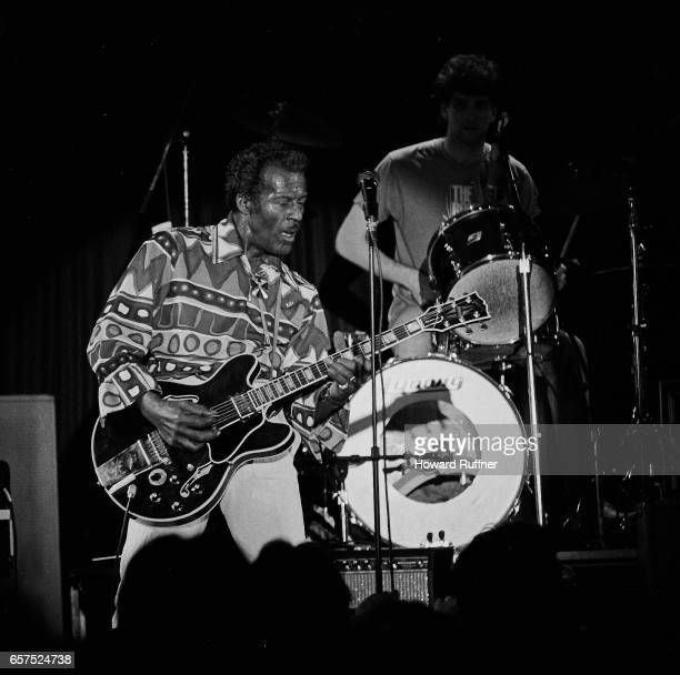 American Rock musician Chuck Berry plays guitar as he performs onstage, Cleveland, Ohio, March 21, 1986. The concert was held on the 34th anniversary...