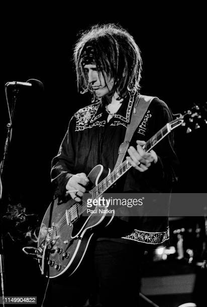 American Rock musician Izzy Stradlin plays guitar as he performs with his band Izzy Stradlin The Ju Ju Hounds onstage at the Metro Chicago Illinois...