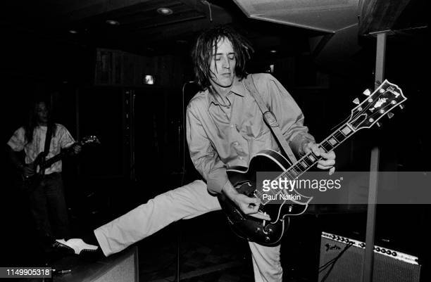 American Rock musician Izzy Stradlin plays guitar during a studio session with his band, Izzy Stradlin and the Ju Ju Hounds, at the Chicago Recording...