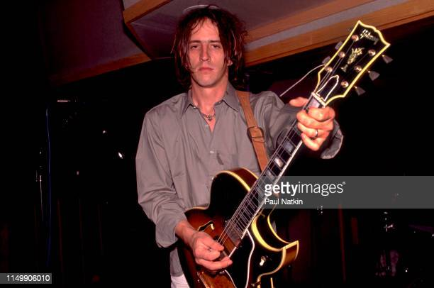 American Rock musician Izzy Stradlin plays guitar during a studio session with his band Izzy Stradlin and the Ju Ju Hounds at the Chicago Recording...