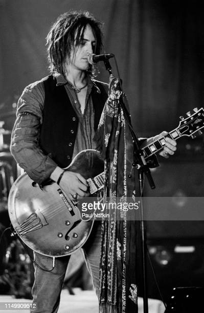 American Rock musician Izzy Stradlin plays guitar with his band, Izzy Stradlin and the Ju Ju Hounds, during a video shoot, Chicago, Illinois, May 15,...