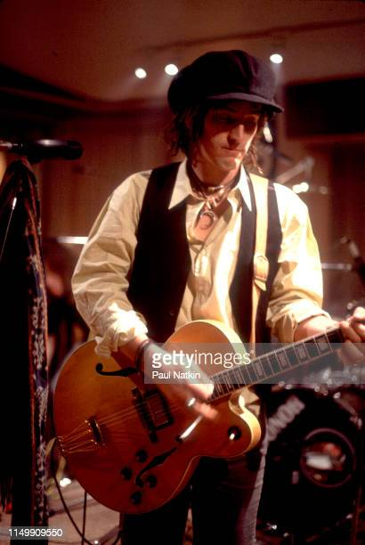 American Rock musician Izzy Stradlin plays guitar with his band Izzy Stradlin and the Ju Ju Hounds during a video shoot Chicago Illinois May 15 1992