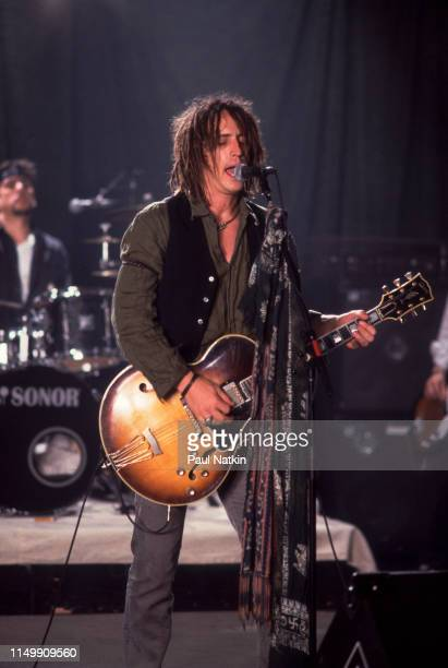 American Rock musician Izzy Stradlin plays guitar with his band Izzy Stradlin and the Ju Ju Hounds during a video shoot Chicago Illinois May 15 1992...