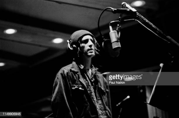 American Rock musician Izzy Stradlin records vocals during a studio session with his band, Izzy Stradlin and the Ju Ju Hounds, at the Chicago...