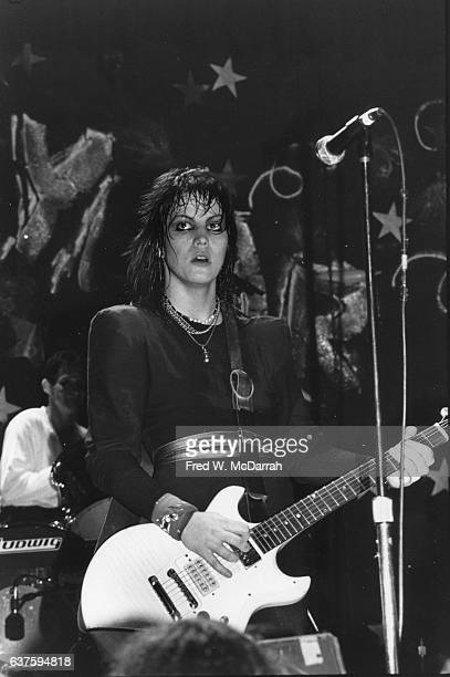 American Rock musician Joan Jett plays guitar as she performs with her band the Blackhearts onstage at the Ritz New York New York December 31 1981