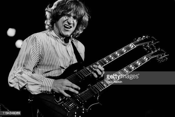 American Rock musician Joe Walsh plays guitar as he performs onstage during Chicagofest Chicago Illinois August 21 1983