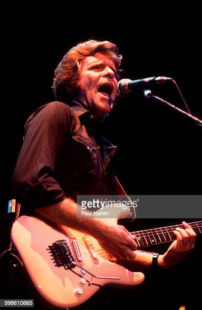 American Rock musician John Fogerty plays guitar as he performs onstage Philadelphia Pennsylvania September 6 1986