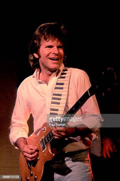 American Rock musician John Fogerty plays guitar as he performs onstage at the Poplar Creek Music Theater Hoffman Estates Illinois September 25 1986