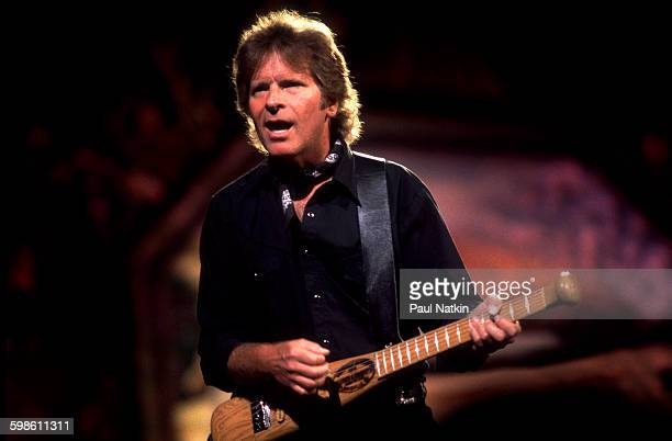 American Rock musician John Fogerty plays guitar as he performs onstage during the Farm Aid benefit concert at the World Music Theater Tinley Park...