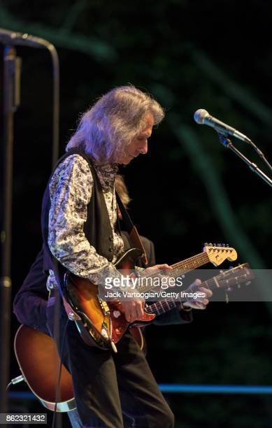 American Rock musician Lenny Kaye plays guitar as he performs with Patti Smith's band during a tribute to Smith's late husband guitarist Fred 'Sonic'...
