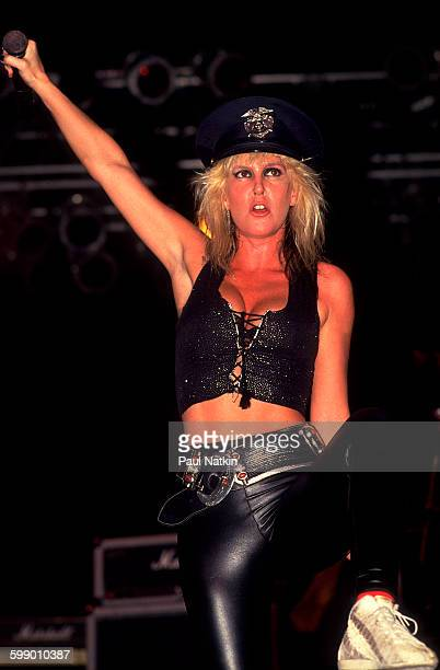 American Rock musician Lita Ford plays guitar as she performs onstage at the Aragon Ballroom Chicago Illinois June 11 1988