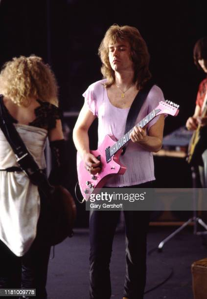 American Rock musician Nancy Wilson and Howard Leese, both of the group Heart, plays guitars as they perform onstage at Giants Stadium, East...