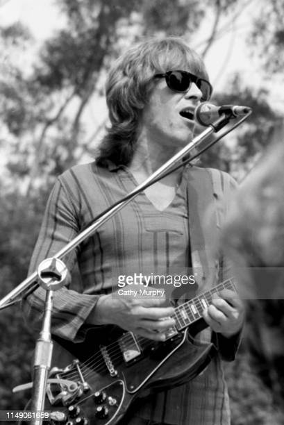 American Rock musician Paul Kantner of the group Jefferson Starship plays guitar as he performs on stage at the Santa Barbara County Bowl Santa...