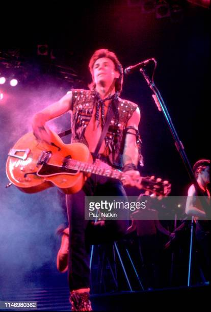 American Rock musician Rick Springfield plays guitar as he performs onstage at the Rosemont Horizon Rosemont Illinois July 6 1983