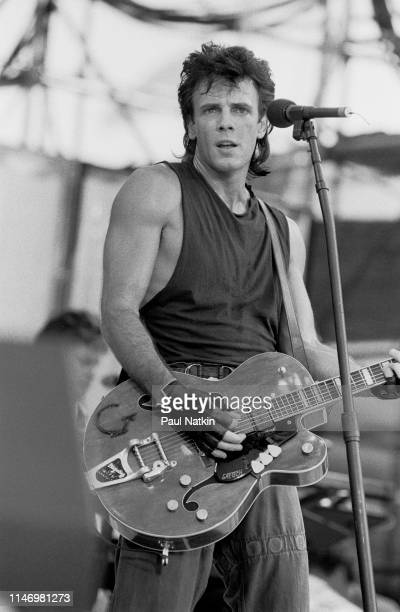 American Rock musician Rick Springfield plays guitar as he performs onstage during the Live Aid benefit concert at Veteran's Stadium, Philadelphia,...