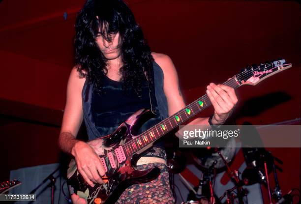 American Rock musician Steve Vai plays guitar as he performs onstage at the Limelight, Chicago, Illinois, June 27, 1987.