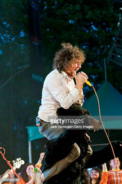 American rock musician Wayne Coyne of the band the Flaming Lips performs from atop a stuffed bear at a Benefit on Central Park's SummerStage New York...