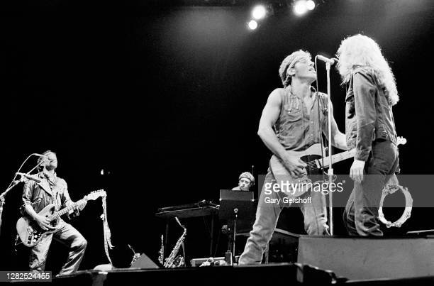 American Rock musicians Bruce Springsteen , on guitar, and backing vocalist Patti Scialfa of the E Street Band perform onstage, during the 'Born in...
